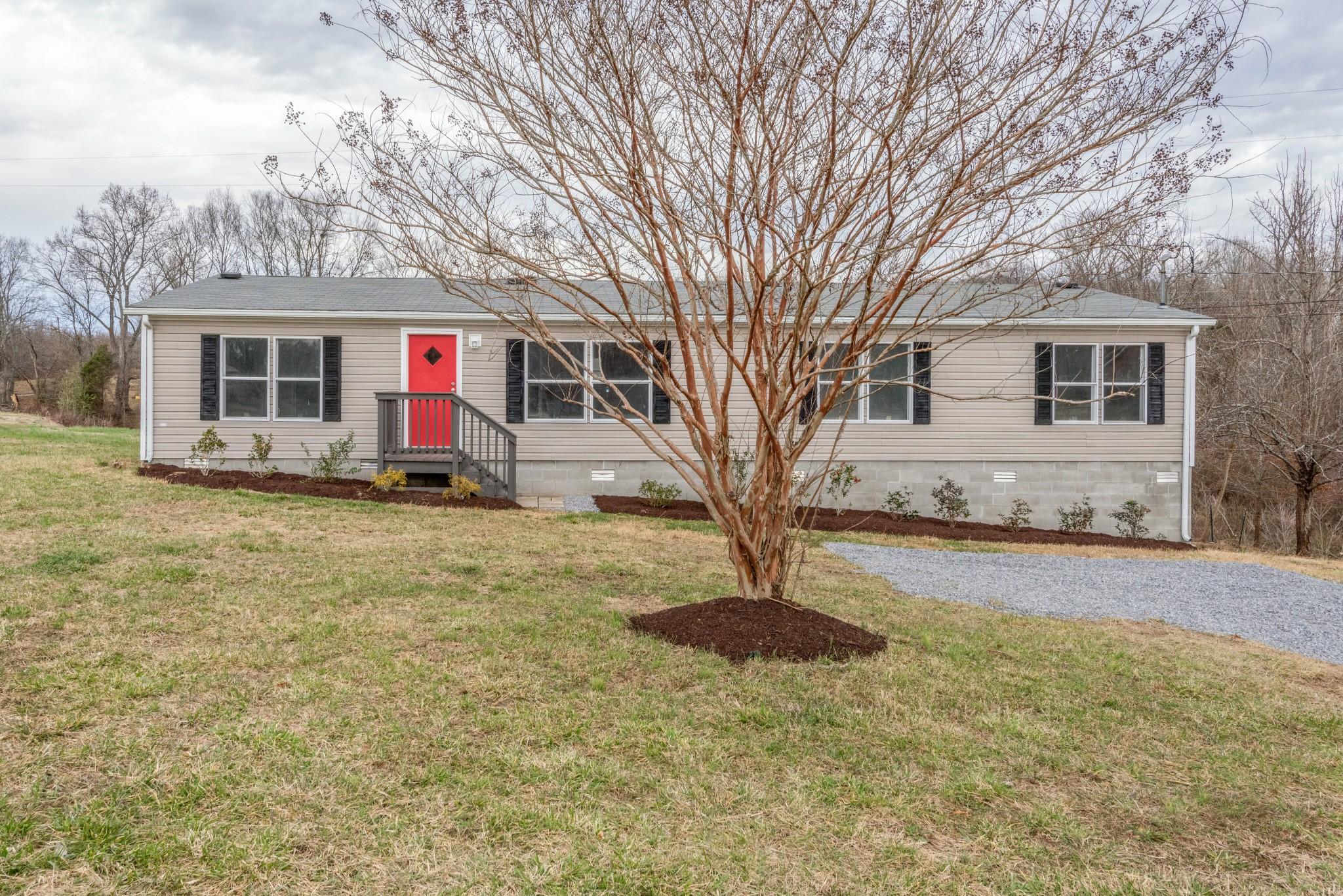 Wow!  Fresh remodel with new kitchen, flooring, paint and much more on 2 acres conveniently located