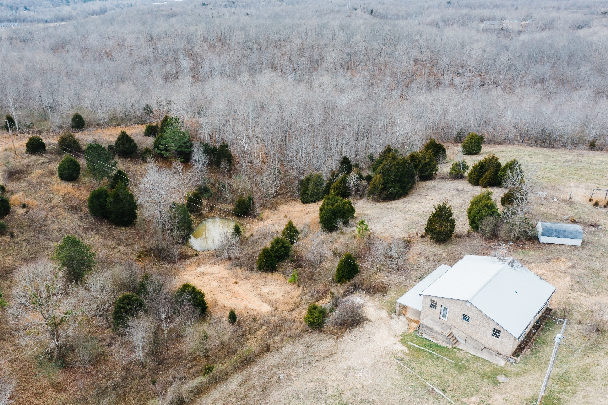 Lovely 30 acres outside Waverly city limits - Home is ready to make your own - Perfect for horses, fences & outbuildings on property - Land is full of trees and has a pond - Home has city water and  a well on property & a septic tank