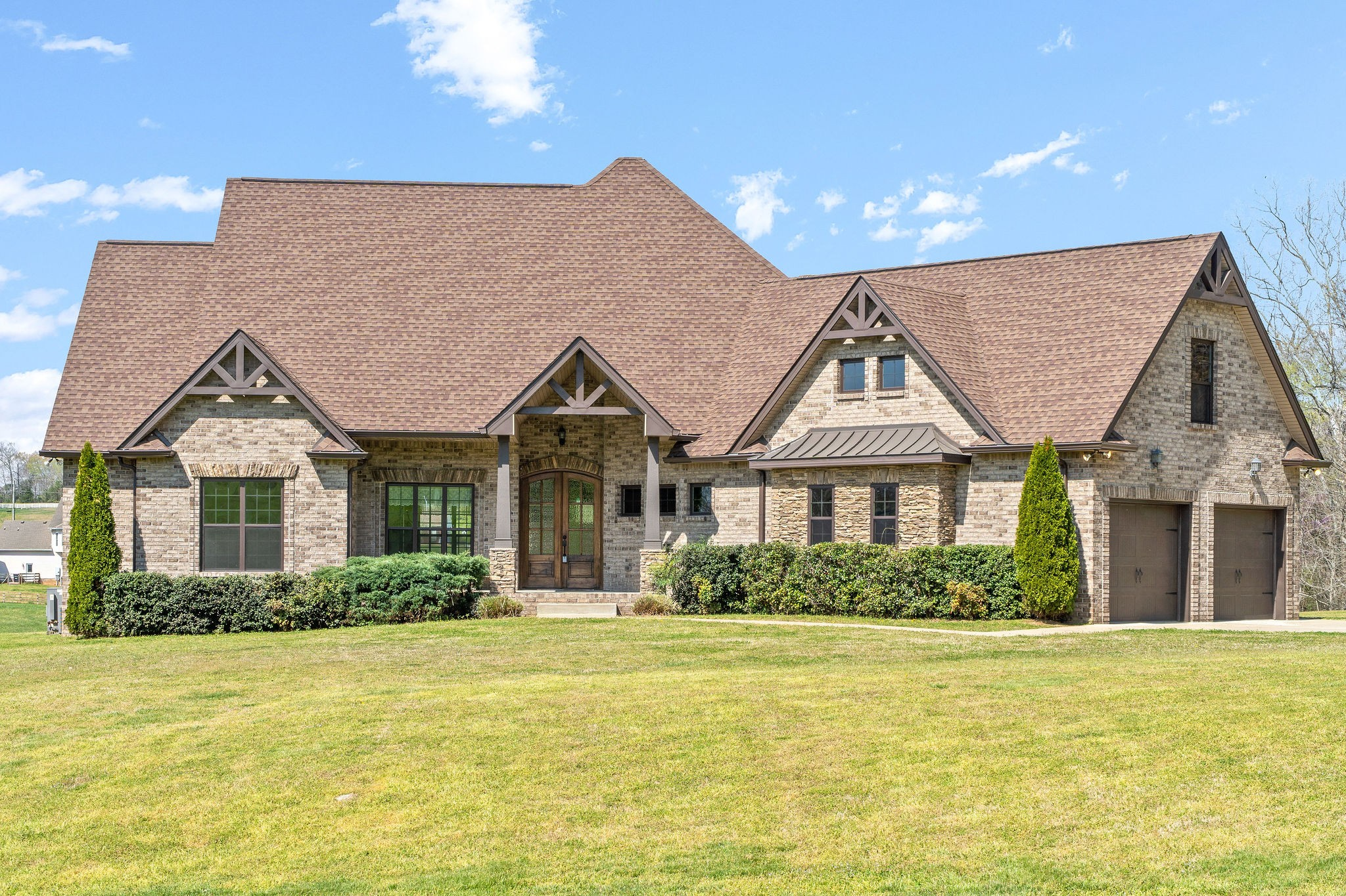 Beautiful all brick ranch home on 5 acres with a 30x40 detached garage! What more could you ask for! Open concept, finished wood flooring thru-out, huge bonus room above attached garage could be addt'l bedroom. Granite countertops in kitchen, kitchen any chef would love to have, WIC Pantry, built-in microwave above oven, gas stovetop, w/ pot  filler, so many options! Addt'l room w/ glass French doors could be used as office/hobby room, or so much more. This great home has been well maintained.