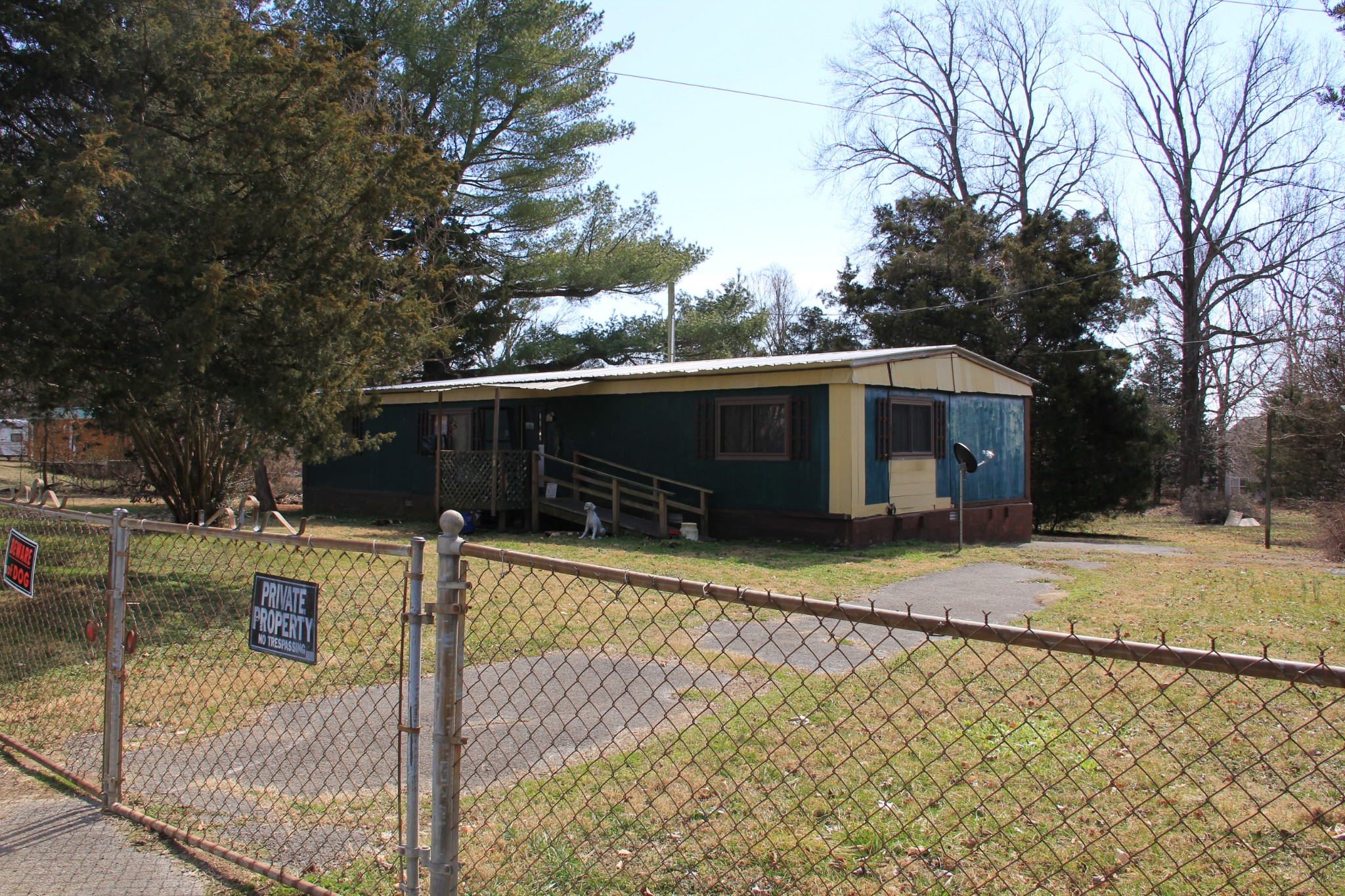 This 3 bedroom 2 bath mobile home is being sold AS-IS, seller will not make repairs.  TLC needed if you are handy it all minor fixes and it sits on a beautiful 1.12 acre lot! Fenced in with shed and privacy, with all that's going on in today's market this is a perfect alternative to multiple offers!  Or consider this an investment property where you can get in quick and potentially lease after construction of a new home in the area, the possibilities are limitless!  BUY THIS HOME!