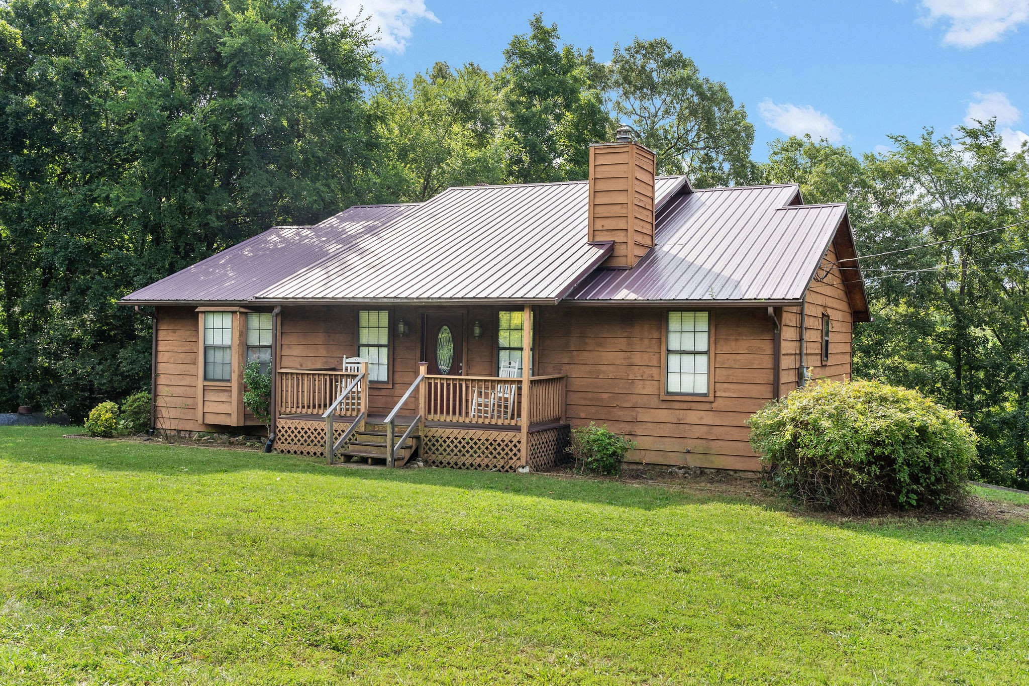 Beautiful cedar sided country home with a full unfinished basement, XL covered back deck with parking and patio underneath, stone fireplace and high ceilings in open living room, 3 Bed/2Bath, almost an acre lot to watch deer and turkeys play, short drive to Clarksville/FTC or LBL