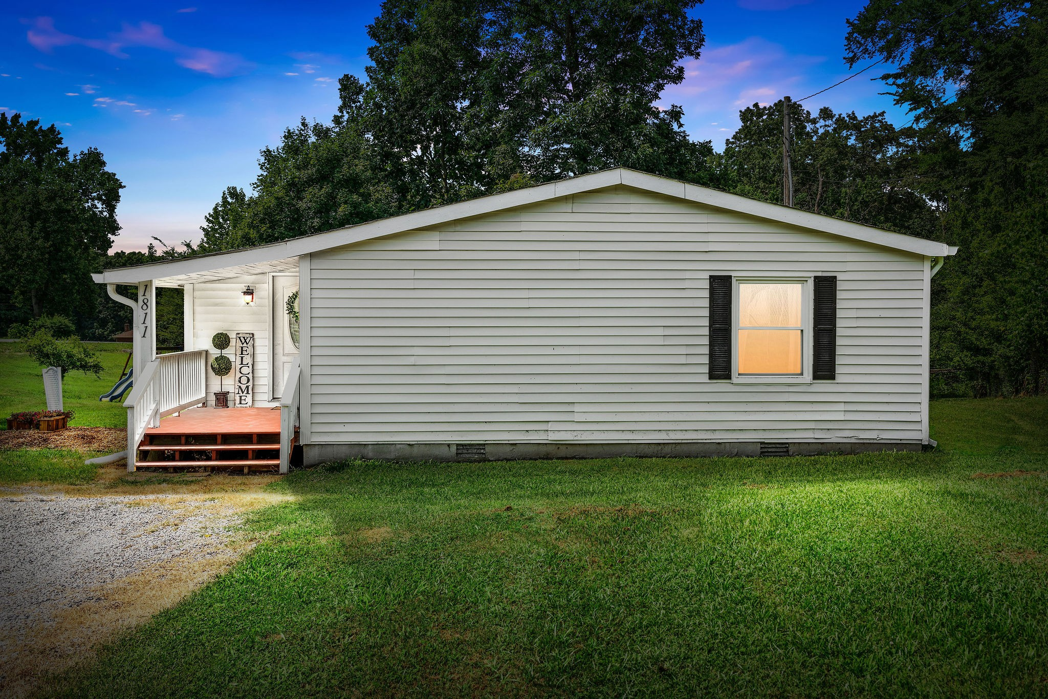 Check Out This Charming County Home Only Minutes to Liberty Park & Downtown Clarksville! - Almost 1/2 Acres Lot - NEW Roof - NEW Flooring - NEW Windows - Newer HVAC Unit Under Warranty! - Fresh Paint - Picture Perfect Kitchen with Stainless Steel Appliances and Custom Cabinetry