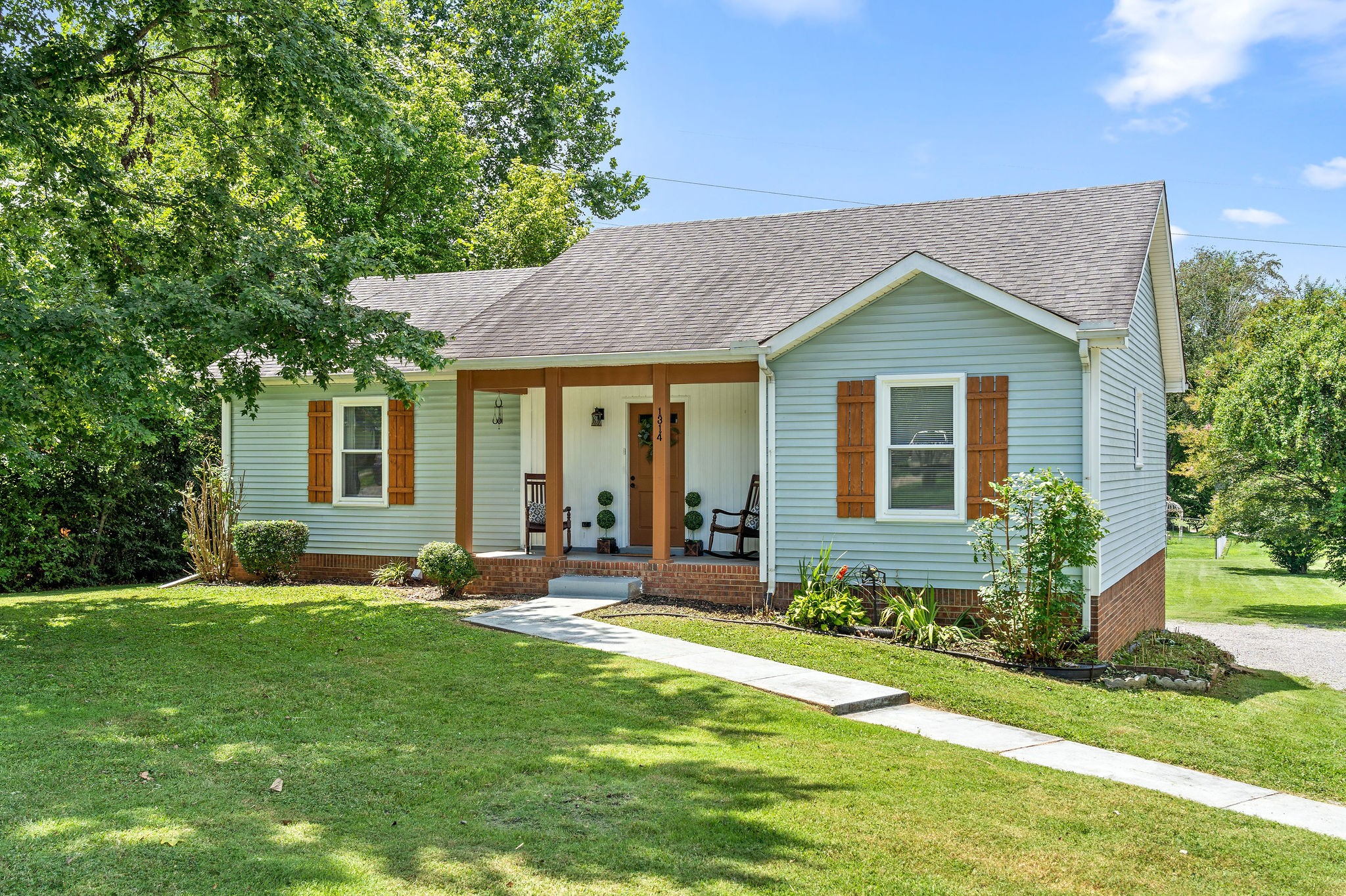 Check Out This Charming Modern Farmhouse Located Near Rossview & Exit 8! - Oversized Backyard at Almost 1/2 Acres Lot Size - Windows, Carpet, Flooring, & Appliances All Updated in 2020 - Shiplap Entryway - Picture Perfect Kitchen with Granite Counters, Subway Tile Backsplash and Stainless Steel Appliances - Renovated Bathrooms