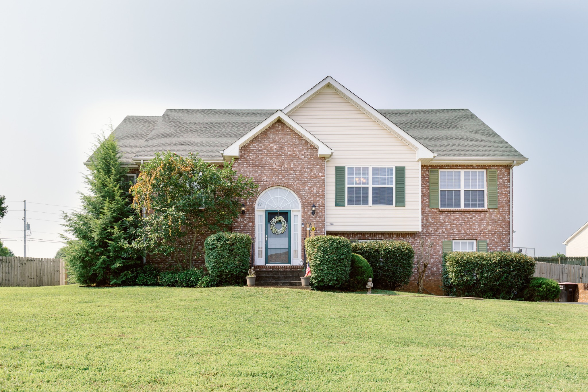 Welcome Home! This Amazing Cozy 5-bedroom home, 3-Car garage, Large fenced back yard. Close to Ft. Campbell and shopping. This home features a Newer Roof (2yrs.) Large Master Bedroom, Spacious Eat-in Kitchen, Fireplace, Dining area, beautiful wood floors in the Living room and hall ways. Downstairs is the Large Rec room, Large bedroom. Seller is offering a one year home warranty with First American. Call to schedule a tour today! This won't last long. MUST SEE!