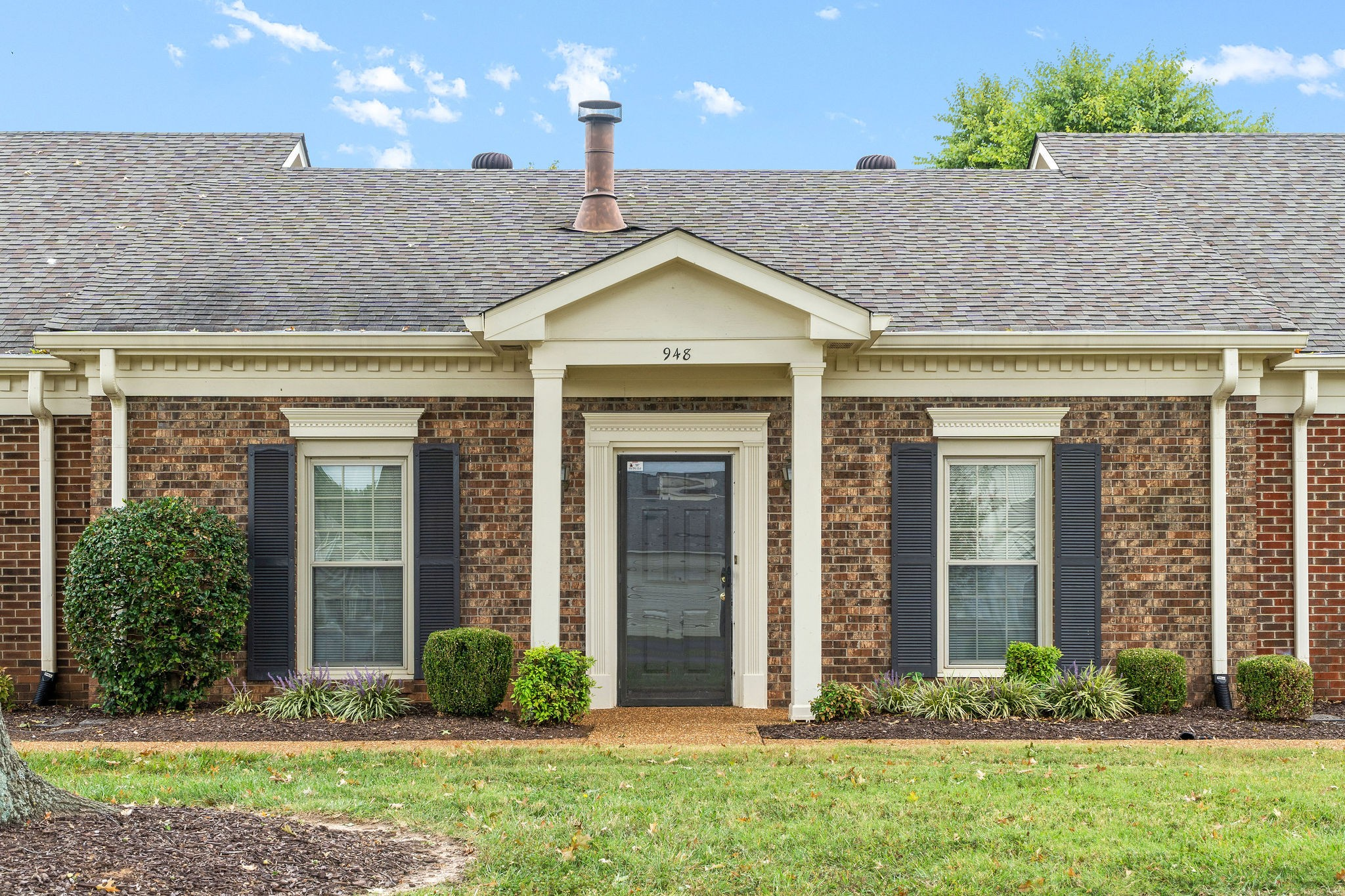 Charming Two Bedroom Town Home In Convenient Location Close To MTSU - Adorable Eat In Kitchen - All Kitchen Appliances Convey - Large Living Room with Wood Burning Fireplace - Community Pool & Tennis Courts, Exterior & Grounds Maintained by HOA - Enjoy The Courtyard And Covered Parking