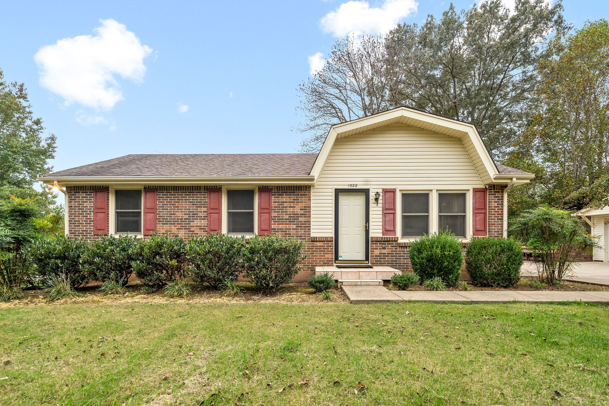 Welcome Home! 3 Bedrooms & 2 Bathrooms on .46 Acres - Fenced Yard with Huge Entertaining Deck - Large Detached Garage with Additional Parking- Master Bedroom with Attached Bathroom - New Roof in 2014 - Central Desirable Location in 37043 - Come See Today!