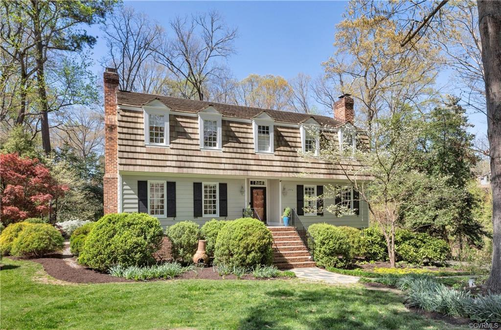 Presenting this handsome Dutch Colonial, wood siding with HENDRICKS TILE roof boasting classic lines