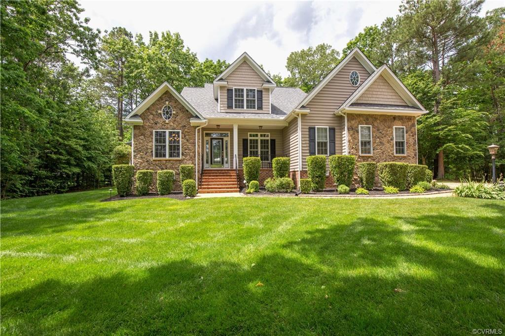 Nestled on a 1+ acre cul-de-sac lot is this beautiful stone fronted Transitional.  From the moment y