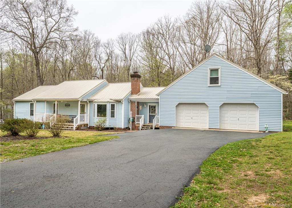 Beautiful Ranch Home with Oversized Attached 2 Car Garage with Workshop and Paved Driveway all on 1