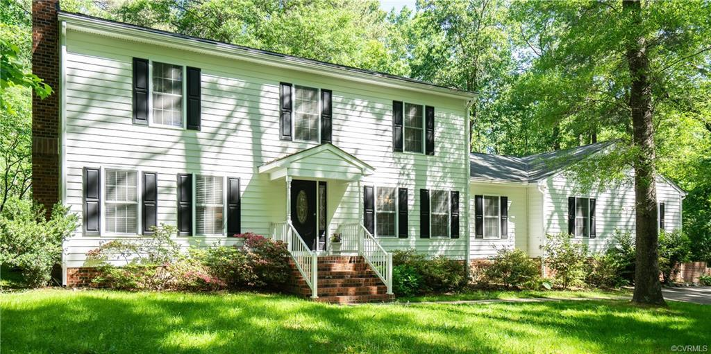 Like-new 5 bedroom, 3 bath home situated on over 3 acres of private, wooded land.  Leaded glass entr
