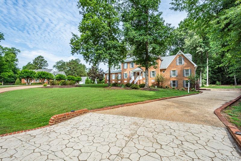 Stunning Brick & Vinyl Custom Colonial with 4 Bedrooms, 2.5 Baths & over 4,000 SF of pristine living