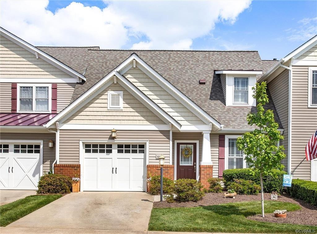 Welcome Home to FIRST FLOOR LIVING! This beautiful Charter Colony townhouse is MOVE-IN READY!  Home