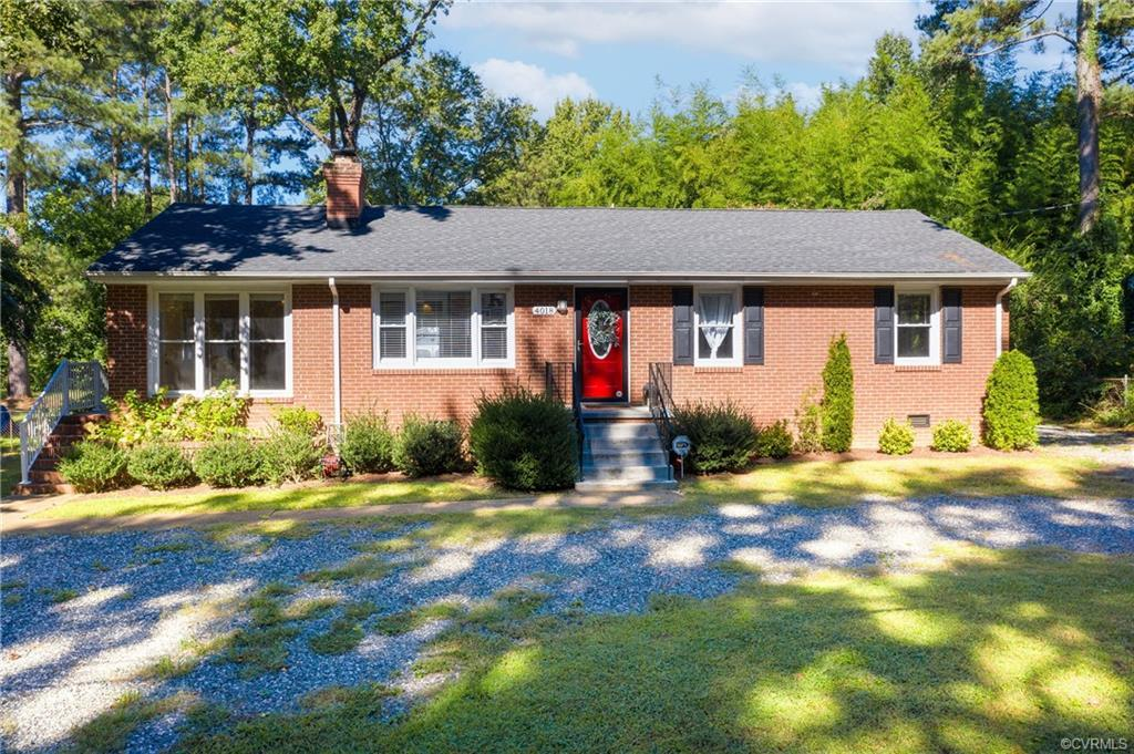 STUNNING & NEWLY UPDATED, COZY MODERN FARMHOUSE featuring a beautiful board & batten entry way w/ a