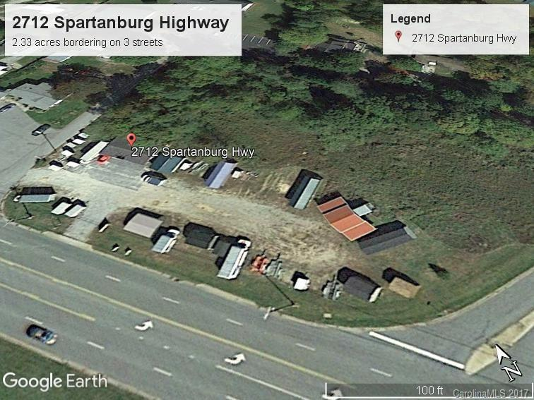 Very nice 2.3 ac corner lot on Spartanburg Highway & Tabor Rd in Hendersonville NC across from the General Electric Plant. Lays well with Frontage on 4 streets with all utilities. 2016 Av daily traffic count  5000-10,000. Great location for gas or convenience store. High visibility. will consider trade, or Possible owner finance  with negotiated terms. 700 sq ft building.