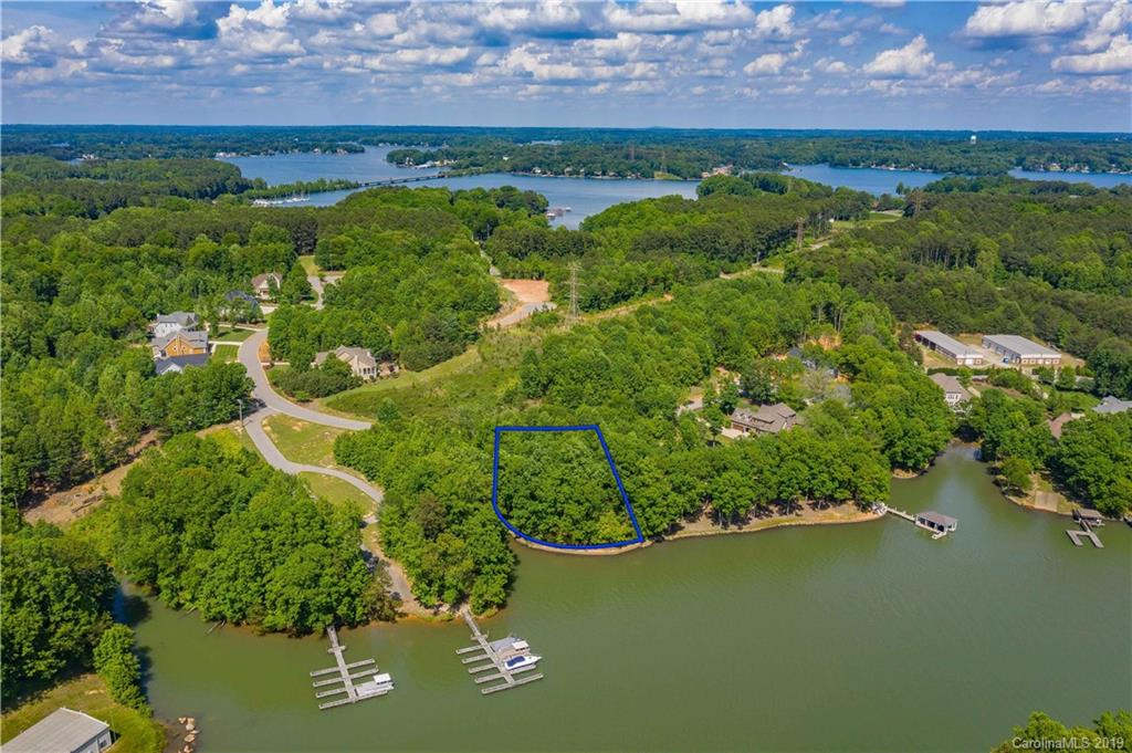 Live where you play.  Gorgeous waterfront lot with approximately 200 feet of shoreline in the gated community of Hidden Harbour.  Wooded lot on paved street that ends in a cul de sac.  Almost 1 acre, 200 wide and 195 deep, level lot with retaining wall along the waterfront side. Nice lake views and deep water. Conveniently located off HWY 150 in between Mooresville and Denver.  Only 45 minutes to uptown Charlotte.  HOA dues $125 quarterly and $200 lot transfer fee to be paid by the buyer.  The back of property on the lake side has a small flood zone; see attached plot plan for more information