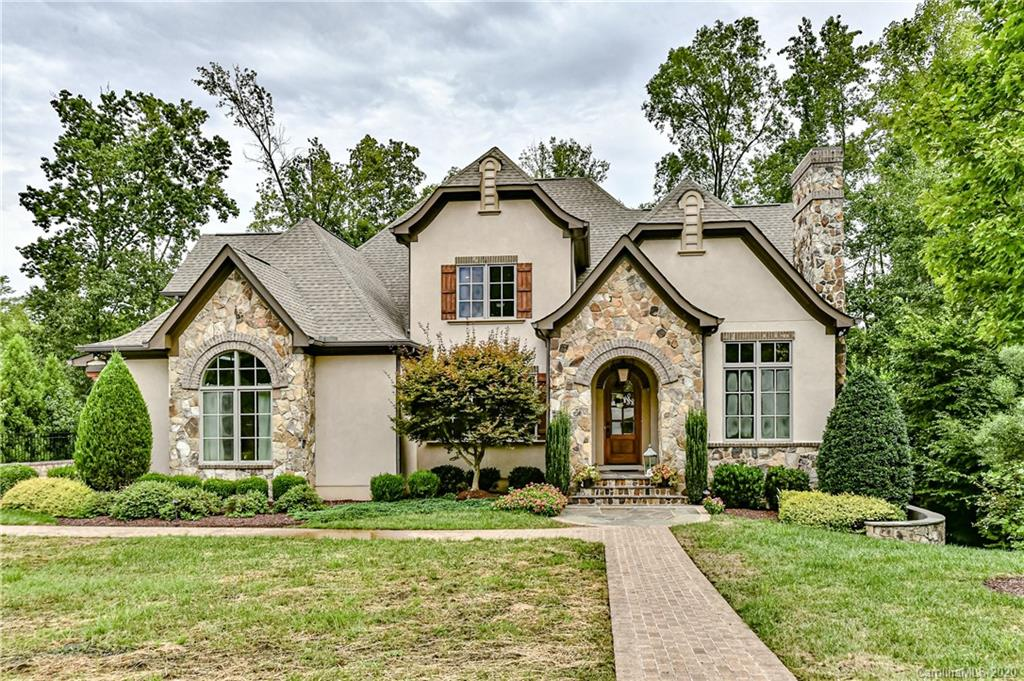 This stunning home is located in Indian Land's premier gated Longbrooke community, just minutes south of Ballantyne.  Enjoy lower SC taxes in this custom built European style home beautifully appointed w/ luxury custom finishes throughout. Master on main w/ spa-like bath, covered balcony & terrace, gourmet kitchen, drop zone, butler's pantry, formal dining, 3 gas fireplaces, foyer w/ reclaimed wood accent wall. Upstairs has 4 bdrms plus bonus.   Incredible finished basement perfect for entertaining w/ kitchen area, huge great room recreation area, exercise room & bedroom suite, abundant storage space. Basement opens to backyard paradise with gorgeous stone & travertine patio, spectacular 18x34 heated salt water pool & spa, outdoor kitchen &