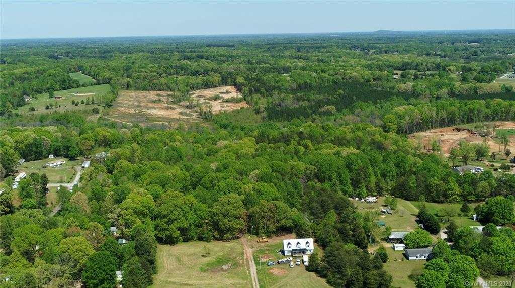 Approximately 10 acres in Troutman area right off Weathers Creek Road. This is one parcel of three contiguous parcels for sale. Two additional parcels are 34.1 acres, and 5 acres, making a total of approximately 49 acres. Access is through this parcel which borders paved Weathers Creek Road. May not be bought separately.  Flat, slightly rolling land with shallow creek behind, suitable for nice homesite or subdivision potential with the other two parcels. Entry is to the left of 513 Weather's Creek, gravel drive, which goes through onto the larger parcel.