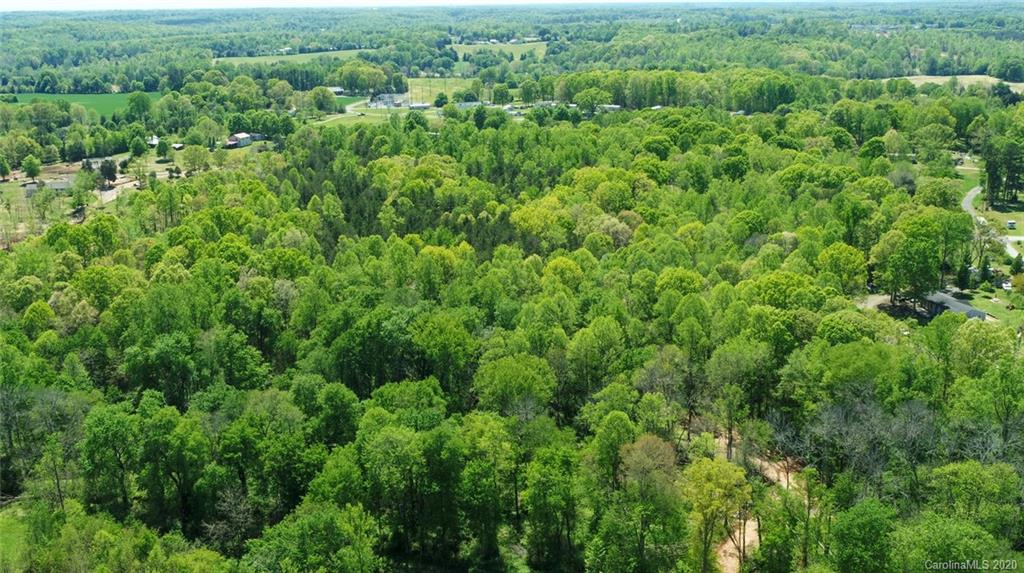 Approximately 34.1 gorgeous acres in Troutman area off Weathers Creek Road.  Private and secluded, flat and rolling land, mature hardwoods and some cleared acres.  Suitable for many uses; Farmland, Gardening, Horse Farm, Mini-Farm/ Estate, Recreational/ 2nd Residence.  Subdivision potential.  Many excellent possible homesites. There are many signs of wild game and trails within this acreage.  This is one of three contiguous parcels for sale.  Two additional parcels are 5 acres, and 10 acres, making a total of approximately 49 acres.  Access for this acreage is through the 10 acre parcel #4760-26-0545 which borders paved Weathers Creek Road.  The ten acre parcel will not be sold separately.  Entry is to the left of 513 Weather's Creek, grave
