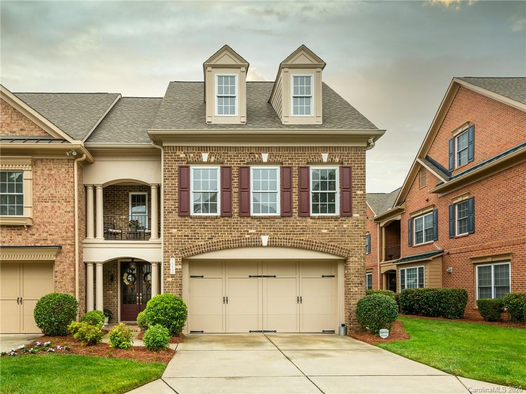 HIGHLY-DESIRED 3-story ALL-BRICK townhome in The Gates at Bridgehampton Community! Covered front por