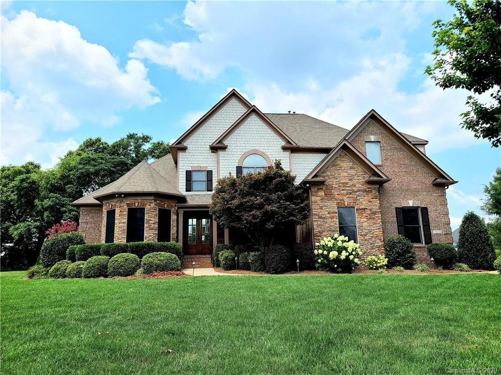 Beautiful former model home in a neighborhood of custom homes on large lots. This full brick w/stone home is sure to impress. Grand foyer entrance with Juliet balcony greets you as you proceed to the living room with a 12 foot coffered ceiling and attractive stone fireplace bordered by 8 foot doors to deck for great entertaining. Heavy crown moldings Open floor plan and oversized sunroom with 2nd stone fireplace that opens into the kitchen w/SS appliances & granite counters. Windows line the back of the home providing lots of natural light and beautiful views of the park like setting of your private fenced backyard with mature oak and maple trees. Desirable master suite with 12 foot ceilings, spacious shower, garden tub, separate water clos