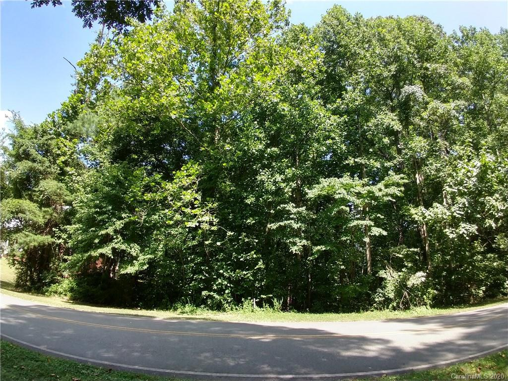 Rare opportunity to build a home right on the golf course in Mooresville!  Property is a beautifully wooded lot on Mallard Head Golf Course. Highly sought-after location! Situated in a secluded and exclusive area, this lot is just down the lane from the Mallard Head Country Club Clubhouse. Close enough to take your cart or walk! Or, just cross your backyard and walk out onto the beautiful green. Property also features a rippling mountain stream down the right property line that is sure to delight. Property has already been surveyed, flagged and staked. Bring your own builder and create your dream home!