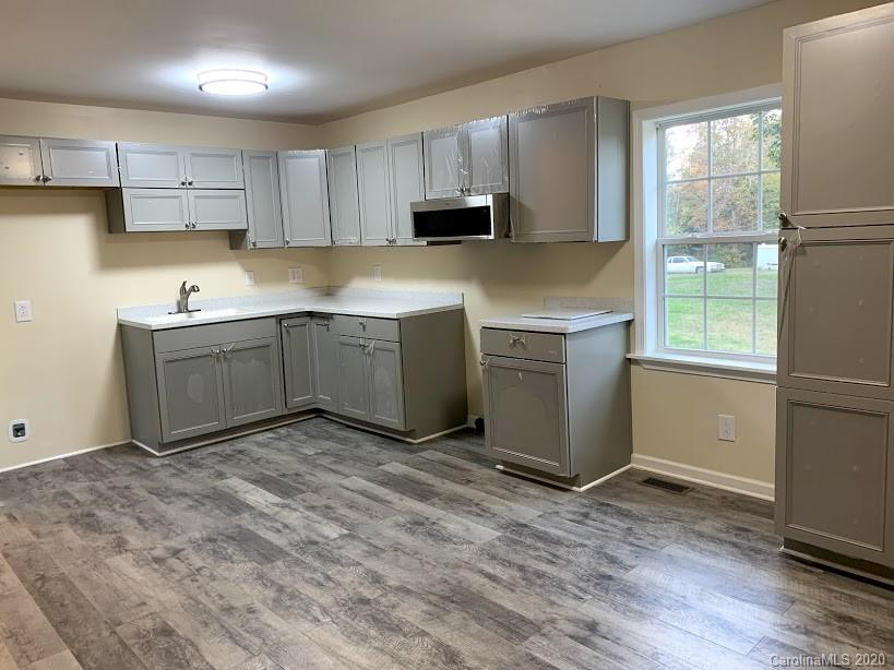 This all brick home offers 4 bedrooms, 1.5 baths, living area and spacious kitchen with dining area. The home features a new HVAC system, water heater, flooring, kitchen cabinets, microwave, and stove. The interior has just been painted too!