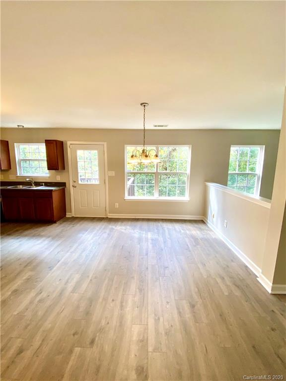 """This beautiful, spacious home in The Woodlands Community is located on a desirable cul-de-sac, backs up to wooded common area w/raised 2-story deck for add'l privacy!  Move-in ready/turn-key home!  Super spacious Primary Bdrm-over 400 sq. ft. w/dual vanity, sep. toilet/huge closet w/view of the woods, Dual HVAC for efficiency/climate control, ceiling fans, freshly painted walls/smooth ceilings/trim/b.boards/sills/int. doors/closets/garage. New laminate flooring on main/bathrooms/laundry rm., new carpeting/upgraded pad in brdms/stairs.  Pressure washed siding/driveway/deck & freshly painted deck.  Kitchen-new appliances refrigerator/range & micro., newer dishwasher, decorative lighting fixtures over island/sink, new w/8"""" deep s.s. sink/fauce"""