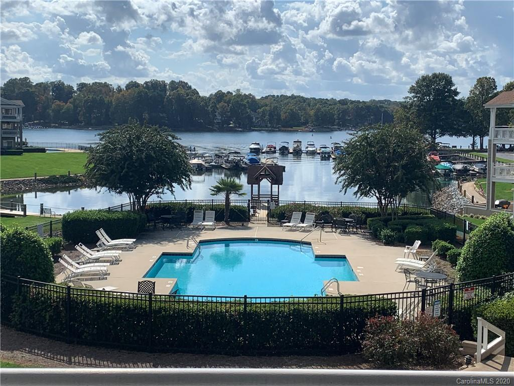 Two bedroom, two bathroom condo in the Captains Watch complex of Davidson Landing. This 2nd floor condo has a split bedroom floorplan with almost 1,200 square feet of living space. Both bathrooms have been updated. Interior has wood floors, carpet, and tile floors. Great Lake Norman and pool view from the large waterfront porch. Porch has access from both the master bedroom and the great room. This plan has the largest master bedroom closet in all of Davidson Landing. Can be sold furnished. Amenities include the lake, pool, tennis courts, fitness/walking trails, basketball court, and leased boat slips. Waterfront restaurant within walking distance.