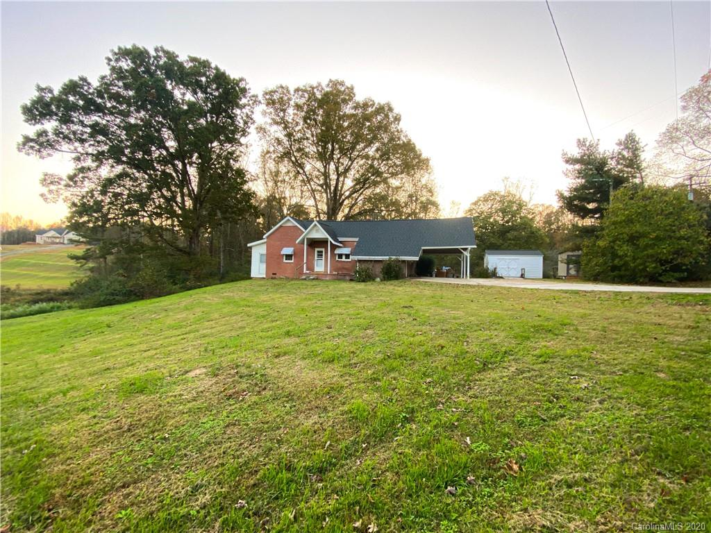 """Brick home located on 5.78 acres (combined lots). Listing includes 2 storage buildings. Tankless Water heater AC replaced this year.   This is an estate being sold """"AS IS""""  Still in process if emptying the back of the house storage and bedrooms."""
