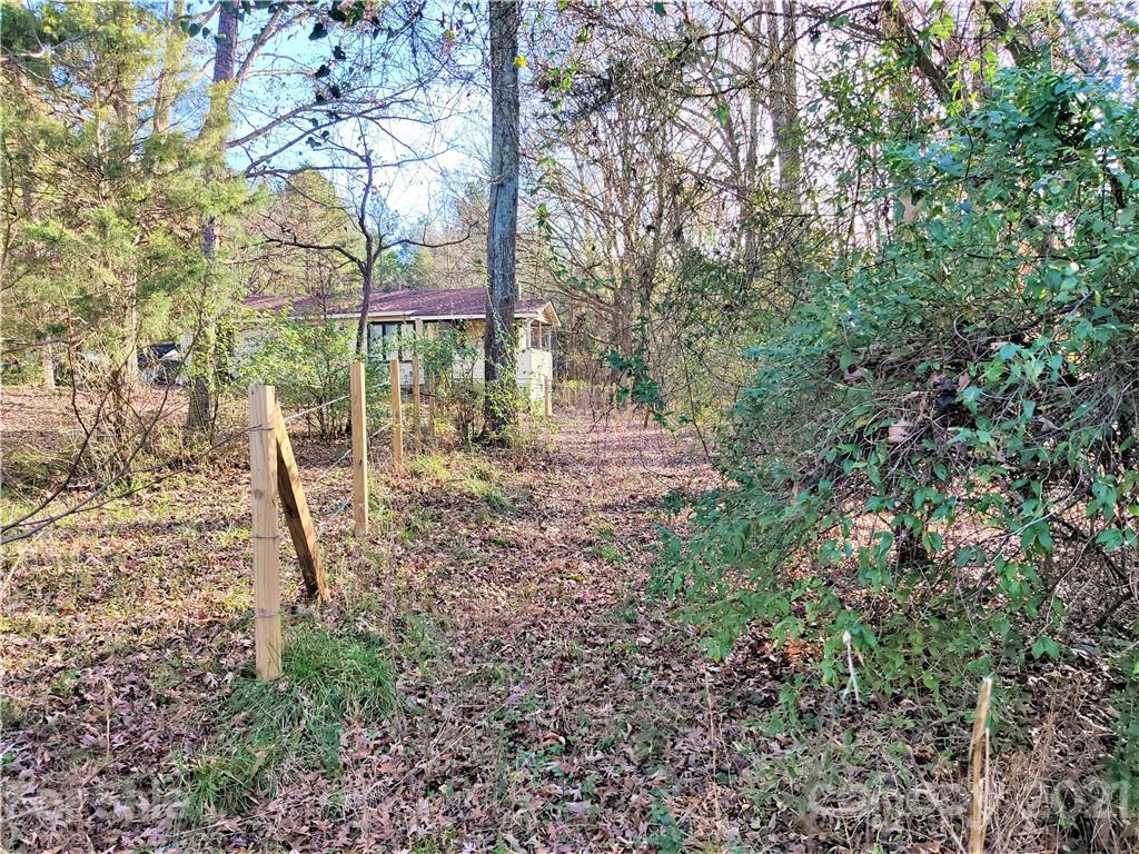 1.24 NICE WOODED LOT, PUBLIC SERVICES AVAILABLE AT THE STREET, QUICK ACCESS TO I-485, AND EASY ACCESS TO THE SHOPING AREAS AT UNIVERSITY CITY. WITH THE COUNTRY LIVING