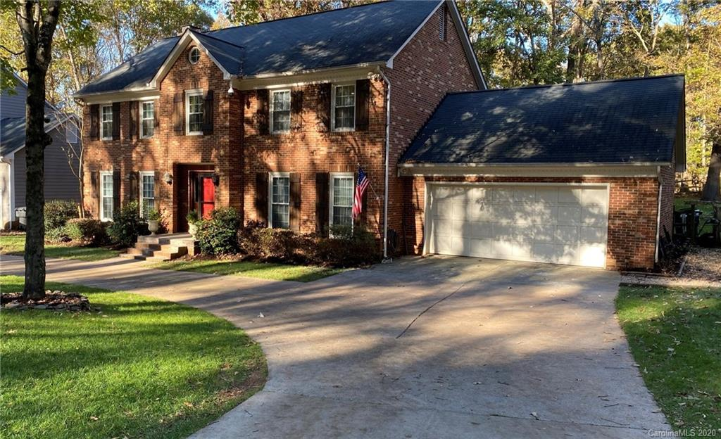 Beautifully updated home in one of Charlotte's most coveted Golf Course Communities.  This full bric