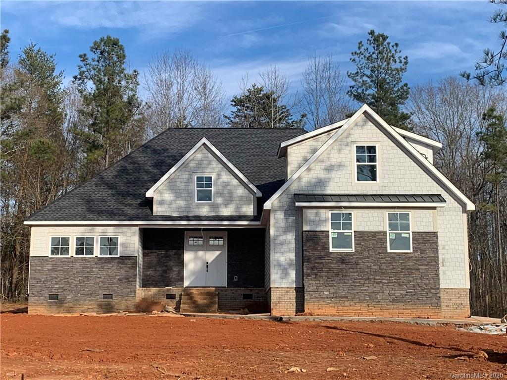 You will fall in love with this cottage-style home featuring a Shaker hardie board front with LED soffit elevation lights. Concrete driveway and two car garage with jackshaft motor.  Coffered ceilings in the foyer and dining area with vaulted ceiling in the living area.  Twelve foot quad sliding door leads from the living area to the rear porch. Walk-in pantry, semi-custom cabinets with soft close, custom 42-inch range hood, 7 foot island and so much more in the kitchen. Drop zone at entrance from garage. The master bedroom features tray ceiling, vinyl wood flooring, a lounge area and door to the rear porch. The master bathroom boasts tile floors, extra large garden tub, custom tile shower with rain showerhead, dual sinks and a water closet