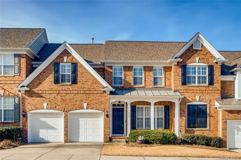 Fantastic all brick townhome in the heart of Ballantyne!  Brand NEW hardwood flooring throughout mai