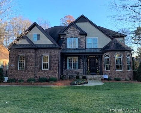 This One Certainly Won't Last!  Stunning All-Brick Home with 3 Car Garage in the Prestigious Gated E