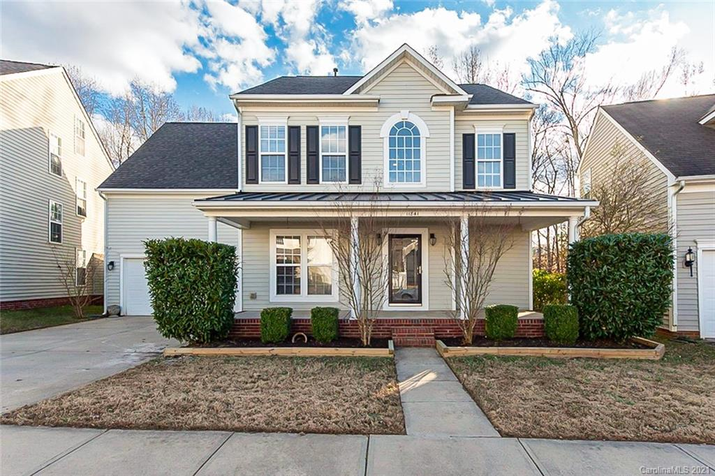 This Charlotte two-story home offers granite countertops and a two-car garage. This home is vacant a