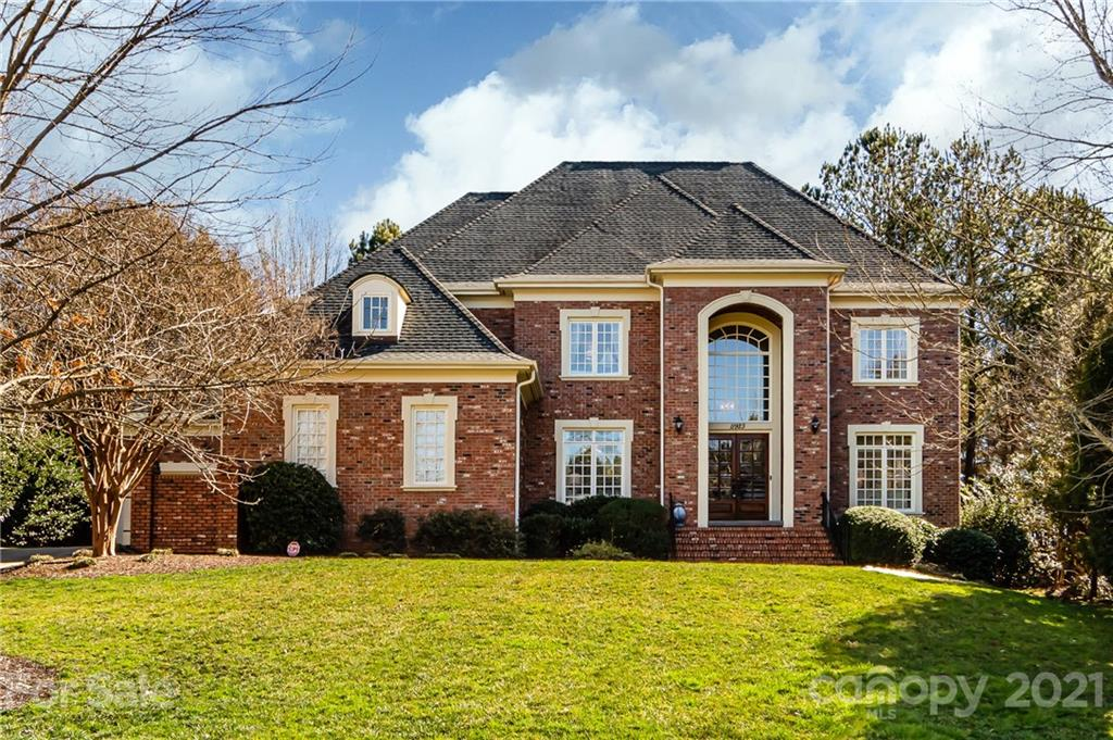 Stunning all brick home in the desirable Ballantyne Country Club w/ 4 car garage & gorgeous chef's k
