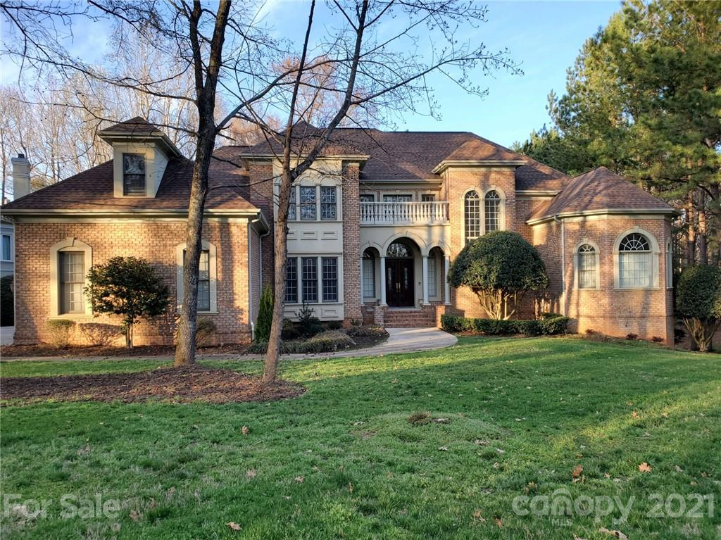 Located in one of the most prestigious sections of Ballantyne Country Club, you'll find 11456 James Jack Lane. Perfectly situated on hole #14, the imagery from this luxury home are second to none! Boasting unprecedented views of the entire fairway, you simply have to see to believe! Not only does the oversized lot offer privacy, (the common area next door is full of pine trees & will not be built upon) it is perfectly placed to add an outdoor pool/living area. Unique features include access from garage to a workshop in the basement complete w/ a golf cart garage and beautifully finished lower bar! Main level boasts open floor plan w/ 2 story ceilings, screened porch off kitchen along w/ oversized terrace, office, computer niche & exceptiona