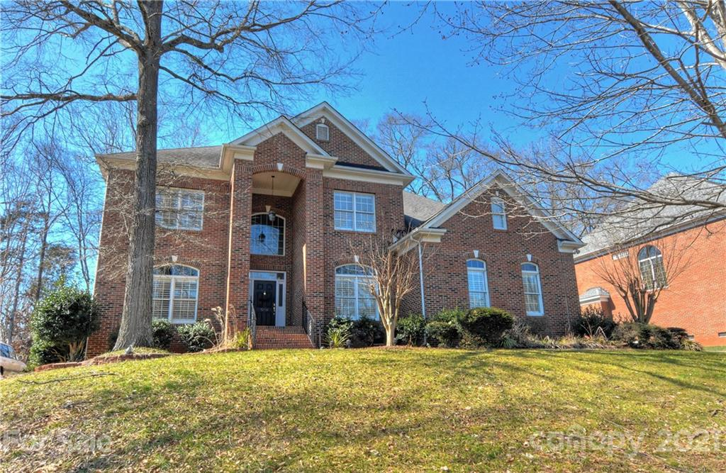 Handsome full brick home in desirable Providence Country Club. Hardwoods just refinished and look br
