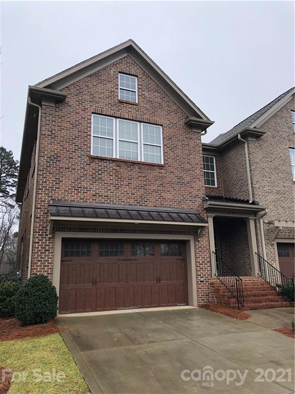 Luxury 2-story townhome in gated community located on the 15th fairway of Providence County Club.  F