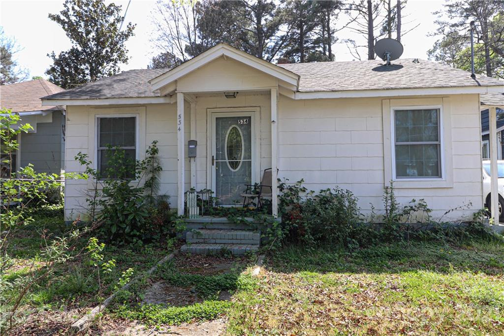 """Excellent opportunity to own this affordable, income-producing, 2 bedroom, 1 bath bungalow! Located within walking distance of downtown Rock Hill, close to restaurants and Fountain Park. Property to be conveyed AS-IS, seller will not make repairs. Seller has never lived in home. Buyer to verify all information. Property is zoned MF-15 with new land use designation """"residential infill"""" allowing property owner to build a 2nd dwelling unit on the property; subject to City land use standards and board approval, see attachments."""