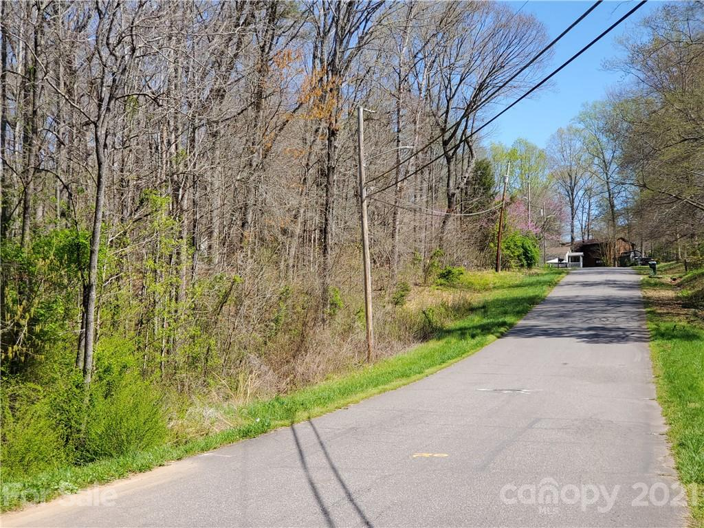 Large residential lot in existing neighborhood. . Lots of trees and a creek on this lot. Easy access to shopping, Interstates 77 and 40 and employment centers. See agent for details and plats. Water and sewer are available for this lot at the existing street.