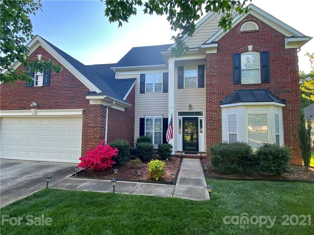 Newly-renovated 5 bedroom home in the heart of Ballantyne featuring a sought-after main floor master