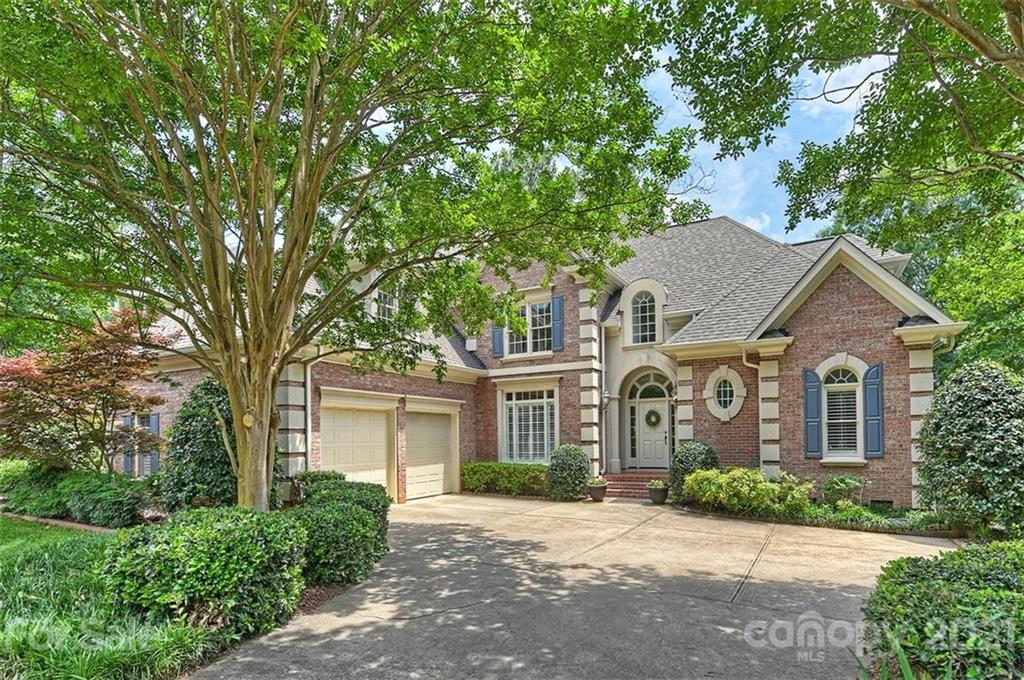 Stately all brick home with mature trees located on one of Ballantyne CC's favorite streets! (Walk d