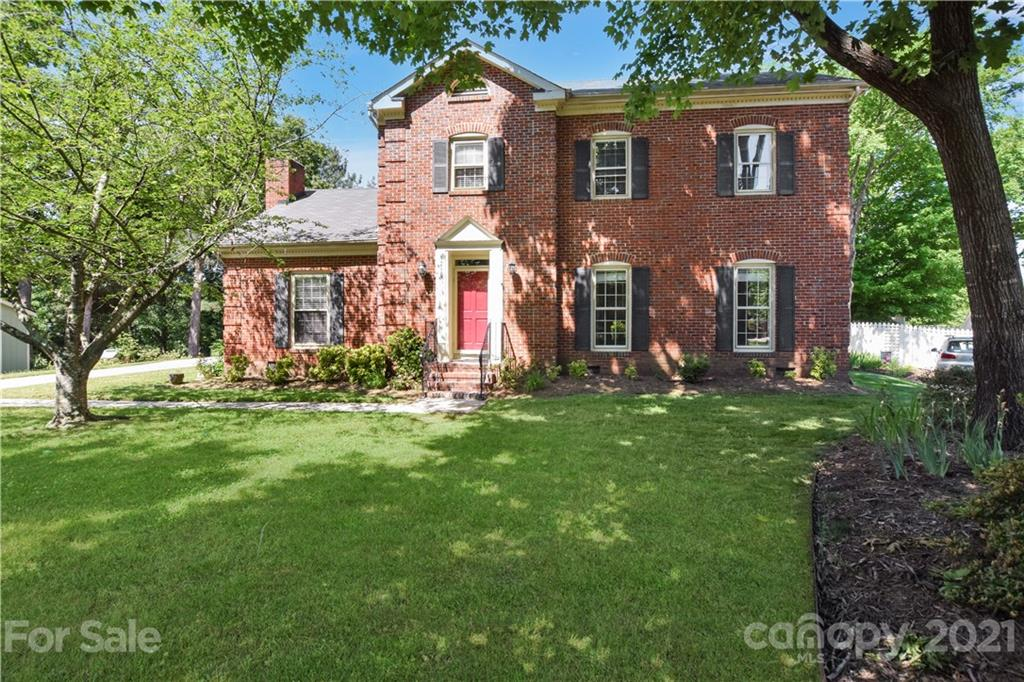 This adorable brick home is on a quiet cul-de-sac lot with mature trees and large yard is only minut