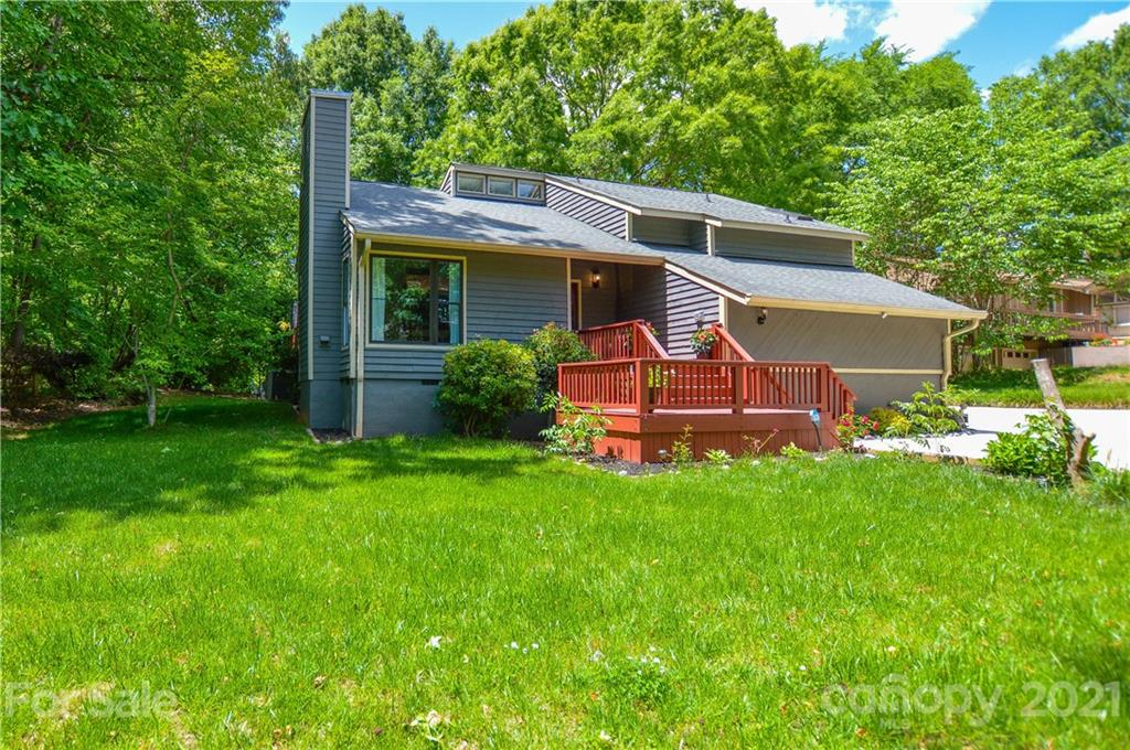 Amazing, completely renovated, Contemporary style 4 Bedroom, 3 Full Bath home on a half acre wooded