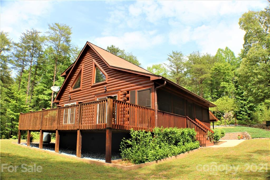 Welcome to your Future Home & Mountain Escape! This Cozy Log Home, has been meticulously maintained by the Seller. Offering all Log Walls on the Ext. Main Level & Wood/Log Siding on Ext. Upper Level. Interior Walls offer Log or Wood Walls through-out & Tile Flooring in All Original Rooms ~ Including the Living Rm, Dining Rm, Kitchen, Loft, 2 Bedrooms & 2 Baths. Features Gas Logs, Granite Countertops & Stainless Appliances. The Bonus/Laundry Room was converted from a 1 car garage in 2012, to offer additional Living Space & always had Heat & Air. Additional Windows & a French Door with a Screen Door were added ~ Floor is the original concrete slab. Property is Landscaped w/ Beautiful Hedges, Juniper, Fruit Trees by entry & Mountain Laurel thr