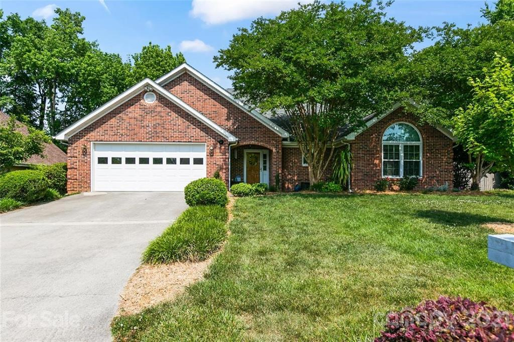 SELLERS HAVE RECEIVED MULTIPLE OFFERS AND ARE ASKING FOR ALL OFFERS TO BE IN BY 2:30PM THURSDAY JUNE 3RD.  THIS BEAUTIFUL ALL BRICK RANCH WON'T LAST LONG! This split floor plan features a large living room with gas fireplace, a spacious master bedroom with luxury vinyl plank flooring and tray ceiling and bathroom with dual sinks, soaking tub and separate shower. The other 2 bedrooms are plenty generous. The large kitchen has granite countertops and stainless appliances and tiled floors.  Enjoy a relaxed family meal in the breakfast area. The master bedroom has luxury vinyl plank flooring and a tray ceiling. The sunroom provides additional living area which can be utilized year round. BRAND NEW WINDOWS THROUGHOUT THE ENTIRE HOUSE - December