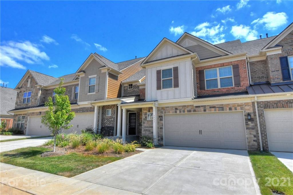 Enjoy upscale living in this beautiful Pulte townhome in Bridgemill.  Fantastic location just minutes to Ballantyne, I485, dining and shopping. This home has beautiful upgrades to flooring, white quartz counters, upgraded white cabinets and subway tile, Gas range and stone fireplace are just a few to name.  Spacious owners suite with HUGE walk in closet that will be sure to please!  Be sure to check out the resort style amenities:  Pool, fitness center, tennis courts and walking trails.