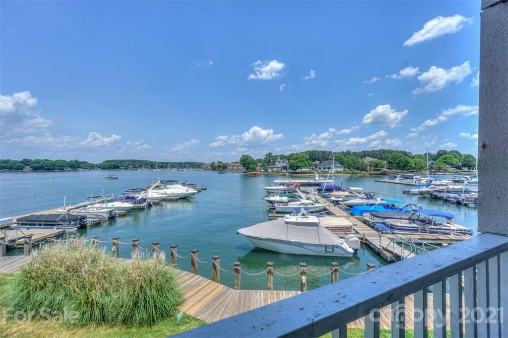 Beautiful Lake Norman view from this Vineyard Point waterfront condo. This three bedroom two bathroom condo is located in The Moorings complex of Vineyard Point. Second floor location with excellent view of the lake and marina. Condo features tile floors throughout the living area and carpet in all three bedrooms. Kitchen has updated cabinets and countertops. Both bathrooms have been updated with walk-in tiled showers. Large waterfront porch to enjoy the view. Amenities included the lake, pool, and tennis.