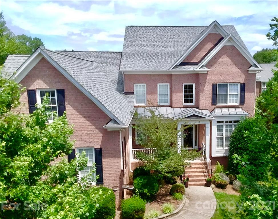 """Immaculate Home - """"Original Owners"""" - MUST SEE!! Gorgeous move-in ready full brick home in Ballantyne. Charming two story arched Foyer. Stunning two story Great Room has multiple skyline windows for an abundance of natural light and spectacular view at night. Office has elongated windows. Beautiful solid oak hardwood floors on main level to greet the Master Bedroom and luxurious Master Bath. Beyond the elegant eat-in kitchen with granite countertops and stainless-steel appliances is a convenient powder room and generously appointed laundry room. Second floor boasts a balcony overlooking the Great Room and Foyer; Three spacious bedrooms as well as a bonus room with built in office desk. Extensive crown molding! Fresh paint/re-finished hardwo"""